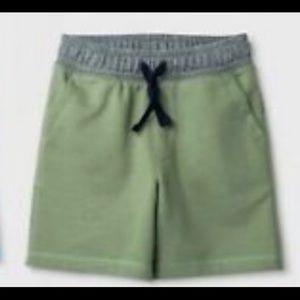Green short shorts w/ grey waist band &navy straps